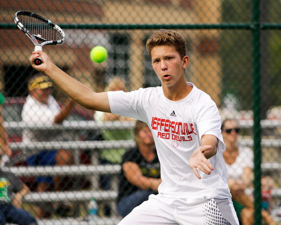 Jeffersonville sophomore Jack Reilly moves to return the ball during his No. 1 doubles match with sophomore Sam Coward against Floyd Central seniors Jack Stoner and Harrison Davis on Wednesday at Floyd Central. Staff photo by Christopher Fryer
