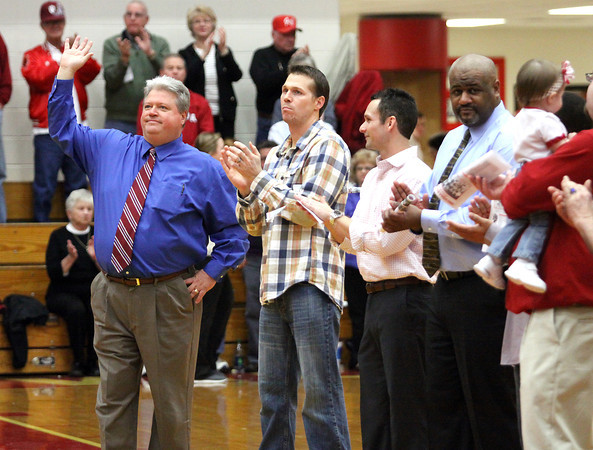 Former Jeff coach Mike Broughton waves to the crowd as the Jeffersonville High School 1993 IHSAA State Champion basketball team and coaches were honored on the 20th anniversary of the title winning season. Staff photo by C.E. Branham