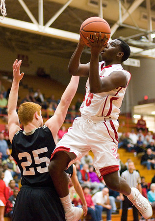 Jeffersonville's Jacquari Chandler goes up for a shot during their home game against Corydon Central on Tuesday. Staff photo by Christopher Fryer