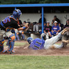 Charlestown player Ryan Jones slides home to score against Silver Creek in the 3A sectional championship game Monday night at North Harrison. Staff photo by C.E. Branham