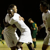 Jeffersonville senior Chase Scott celebrates with junior Leonard Kwitondawith, center, after he scored during the second half of their game against Floyd Central in the Indiana High School Athletic Association Boys Soccer Sectional tournament at Floyd Central on Wednesday. Jeffersonville won the game, 3-0. Staff photo by Christopher Fryer
