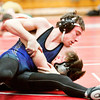 New Washington senior Yancey Crase pins Jeffersonville junior Josh Sauer during their 138-pound match at the Jeffersonville Sectional on Saturday. Staff photo by Christopher Fryer