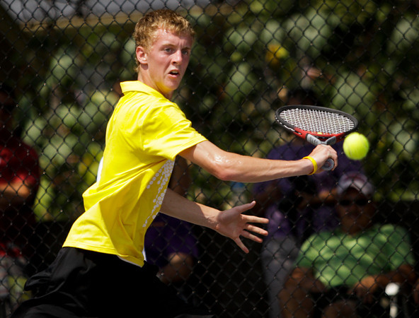 Eastern junior Alex Doebler returns a shot to Scottsburg junior Andrej Halasa during their No. 1 singles match at the New Albany Boys' Tennis Invitational on Saturday. Staff photo by Christopher Fryer