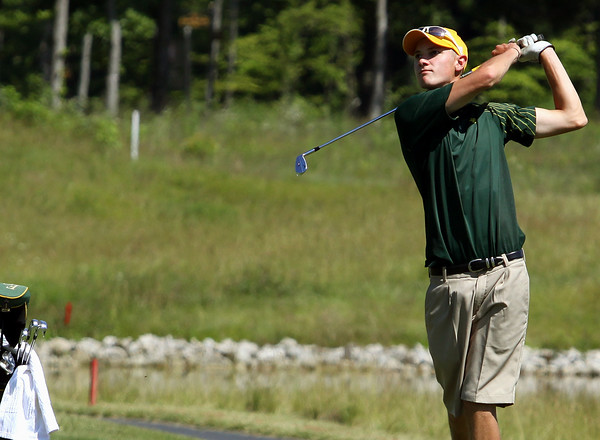 Floyd Central golfer Jay Holderman hits his approach to the ninth green while competing in the IHSAA Golf Regional on Thursday at Champions Pointe Golf Club. Staff photo by C.E. Branham