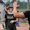 Kayla Wallace is welcomed back to the dugout after scoring for Clarksville in the Lady Generals' 2A sectional game against Paoli. Staff photo by C.E. Branham
