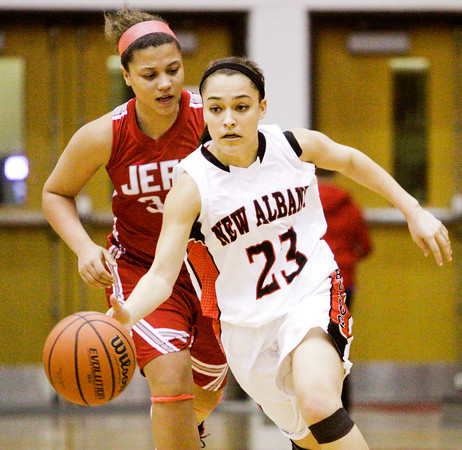 New Albany guard Marissa Jones moves the ball down court during the Bulldogs' home game against Jeffersonville on Friday. Staff photo by Christopher Fryer