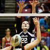 Providence junior Maile Daniel attempts to block a Wapahani shot during their Class 2A state championship match at Worthen Arena in Muncie on Saturday. Wapahani won the match in four sets. Staff photo by Christopher Fryer
