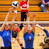 Silver Creek junior Kendra Kirchgessner and sophomore Liz Mann attempt to block a Heritage Hills shot during their match at Providence High School on Saturday. Staff photo by Christopher Fryer