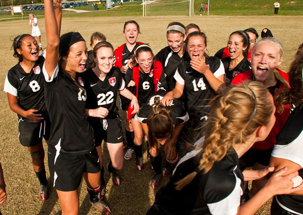 The New Albany girls soccer team celebrates their 1-0 victory over Jasper in the championship game of the Girls Soccer Sectional tournament at Floyd Central on Saturday. Staff photo by Christopher Fryer
