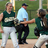 Floyd Central pitcher Morgan Harper and catcher Taylor McClure celebrate a successful hidden ball play in the top of the seventh inning that stopped a Bedford North Lawrence player from advancing to third and got an out. Staff photo by C.E. Branham