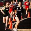 Runners compete in the 3200-relay during the Floyd Central Girl's Invitational track meet on Friday. Staff photo by Christopher Fryer