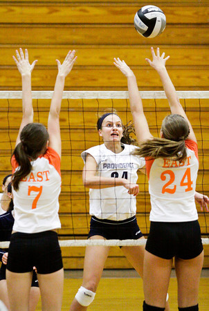 Providence junior Haley Libs goes up for a shot during their match against Columbus East at the annual Providence Early Bird Invitational on Saturday. Columbus East won the match in three sets. Staff photo by Christopher Fryer