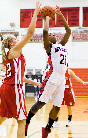 New Albany forward Brianne Nixon goes up for a shot during the Bulldogs' 39-33 loss to Madison at home on Thursday. Staff photo by Christopher Fryer