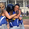 Ashley Johnson, right, and Coari Robertson hug Whitney Leezer after Leezer drove in the winning run in a 1-0 win over Lanesville in the 1A Sectional championship. Staff photo by C.E. Branham