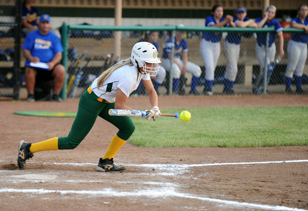 Highlander outfielder Morgan Harper lays down a bunt to move the runners during Floyd Centrals' 7-0 win over Castle in the Class 4A regional Tuesday evening.<br /> Staff photo by Tyler Stewart