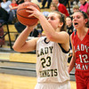 Henryville freshman Emily Hollis shoots a baseline jumper against Borden on Thursday night. Staff photo by C.E. Branham