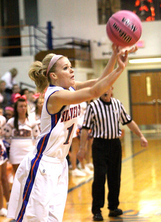 Silver Creek senior Emily Clayton shoots a three pointer agiainst South Central Wednesday night. Staff photo by C.E. Branham