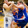 Charlestown's Megan Brooks and Silver Creek's Alex Tinsley fight for a rebound during their game in the Scottsburg sectional tournament on Wednesday. Silver Creek won the game, 51-38. Staff photo by Christopher Fryer