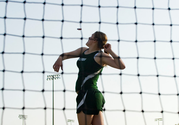 Floyd Central High School junior Leah Wolf throws during the discus competition at the Indiana High School Athletic Association Girls Track Sectional at Floyd Central High School on Tuesday evening. Staff photo by Christopher Fryer