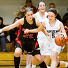 New Albany guard Lauren Camm covers Providence guard Olivia Jenkins during their game at Providence on Friday. Staff photo by Christopher Fryer