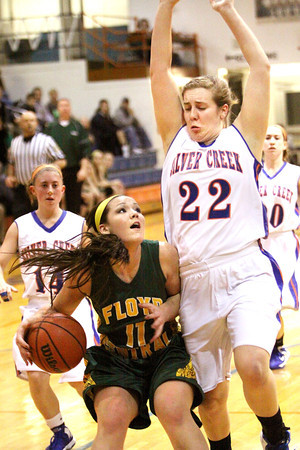 Floyd Central sophomore Madison Kaiser gets Silver Creek defender Alex Tinsley in the air Thursday night. Staff photo by C.E. Branham