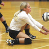Henryville libero Jasmine Harrell digs a Providence serve Monday night at the Larkin Center. Staff photo by C.E. Branham