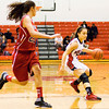 New Albany guard Marissa Jones moves the ball down court during the Bulldogs' home game against Bedford North Lawrence on Tuesday. Staff photo by Christopher Fryer