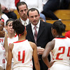 Matt Pait, in his first season coaching the Lady Red Devils, talks to his team during a timeout Friday night in their game against Silver Creek. Staff photo by C.E. Branham