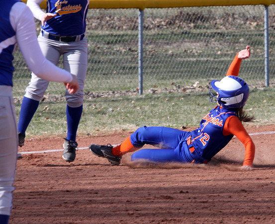 Silver Creek base runner Brooke Barnett steals third base at New Washington Monday afternoon. Staff photo by C.E. Branham