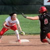 Jeffersonville shortstop Emma Coons waits to tag out New Albany baserunner Brittany Jones Monday afternoon. Staff photo by C.E. Branham