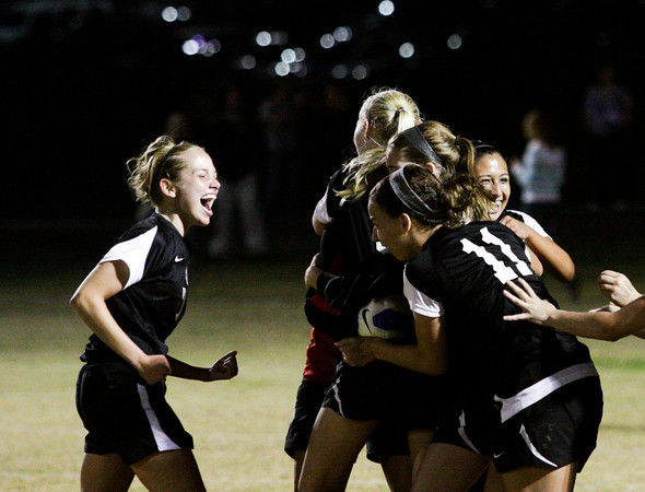 New Albany celebrates their 3-2 victory over Floyd Central after overtime play and a shoot out during the Indiana High School Athletic Association Girls Soccer Sectional at Floyd Central on Thursday. Staff photo by Christopher Fryer
