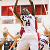 New Albany guard Aaliyah Bell comes down with a rebound during the Bulldogs' home game against Jeffersonville on Friday. Staff photo by Christopher Fryer