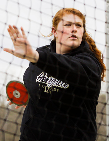 Henryville junior Natalie Uhl throws during the first flight of the discus competition during the Floyd Central Girl's Invitational track meet on Friday. Staff photo by Christopher Fryer