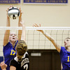 Christian Academy senior Rachel Boesing, left, blocks a shot by Rock Creek junior Susan McCoy during their match in the first round of the Class 1A Christian Academy of Indiana Volleyball Sectional tournament on Thursday. Christian Academy won the match in three sets, 25-17, 25-11 and 25-8. Staff photo by Christopher Fryer