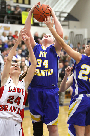 New Washington junior Caroline Ricks pulls down a rebound against Borden in a 1A Sectional game Tuesday night. Staff photo by C.E. Branham