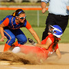 Jeffersonville High School's Tifany Sheet slides safely into third base past Silver Creek High School's Heather Knight during their game at Silver Creek on Friday evening. Jeffersonville won the game, 6-3. Staff photo by Christopher Fryer