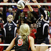 Providence sophomore Maddie Bivens, left, and junior Maile Daniel attempt to block a shot during their Class 2A state championship match against Wapahani at Worthen Arena in Muncie on Saturday. Wapahani won the match in four sets. Staff photo by Christopher Fryer