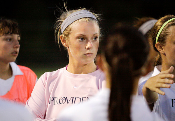 Providence goal keeper Autumn Meyer listens during their huddle before the second half of their home game against Floyd Central on Tuesday. Staff photo by Christopher Fryer