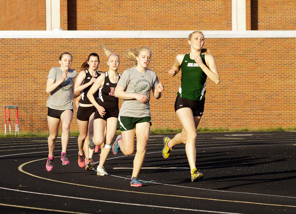 Floyd Central and New Albany runners compete in the 800-meter run during their meet at New Albany on Tuesday. Staff photo by Christopher Fryer