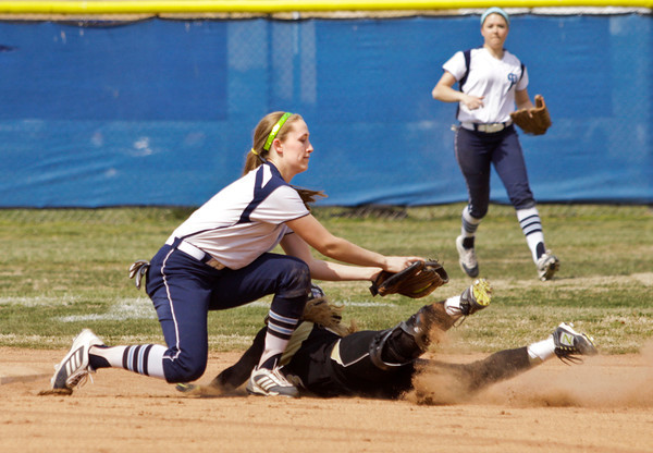 Providence shortstop Jacquie Hornung tags out Loogootee center fielder Madison Zins at second base during the first inning of their game at the Providence Invitational in Clarksville on Saturday. Staff photo by Christopher Fryer