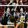Providence sophomores Taylor Wilson, left, and Haley Libs attempt to block a shot during their Class 2A state championship match against Wapahani at Worthen Arena in Muncie on Saturday. Wapahani won the match in four sets. Staff photo by Christopher Fryer