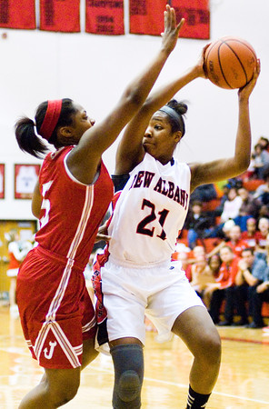 New Albany forward Brianne Nixon moves to pass during the Bulldogs' home game against Jeffersonville on Friday. Staff photo by Christopher Fryer