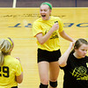 Floyd Central sophomore Remi Bowman, center, celebrates with senior Jordan Alvey, left, and junior Brooke Hinton after they scored a point against Providence during their match at Providence on Tuesday. Floyd Central won the match in five sets. Staff photo by Christopher Fryer