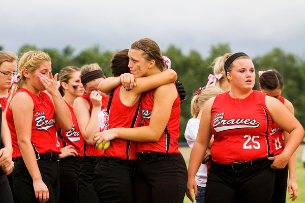 Borden senior Shelbie Farvour, center right, and junior Kristen Nestor comfort each other after the Braves' 3-0 loss at the West Washington Regional on Wednesday. Staff photo by Christopher Fryer