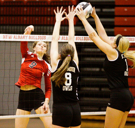 A shot by New Albany junior Alexis Lete is blocked by Seymour during their game at New Albany on Thursday. Seymour took the match in three sets, 25-23, 25-23, 25-14. Staff photo by Christopher Fryer