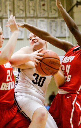 Providence center Lillian Hughes fights for a rebound during their home game against Jeffersonville on Thursday. Jeffersonville won the game, 35-19. Staff photo by Christopher Fryer