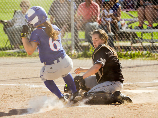 Henryville catcher Emily Stewart tags out Silver Creek's McKenzie Bush at home plate during the Dragons' 9-3 home win over the Hornets on Monday. Staff photo by Christopher Fryer