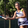 Providence High School No. 1 singles player Jacqueline Hollkamp returns volley in her match with Jeffersonville No. 1 singles player Morgan Reilly on Monday at Jeffersonville. Staff photo by C.E. Branham