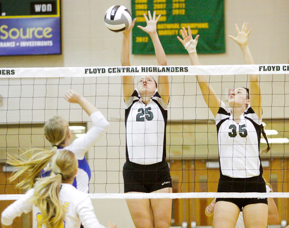 Floyd Central junior Lauren Koopman, left, and sophomore Gwyn Jones block a shot during their match against Castle in the Floyd Central Regional on Tuesday. The Highlanders took the match in four games, 21-25, 25-15, 25-16, 25-21. Staff photo by Christopher Fryer