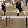 Providence junior Morgan Butler clears the final hurdle in the 300-meter hurdles during the Providence Invitational track meet on Wednesday afternoon at Providence High School. Staff photo by Christopher Fryer
